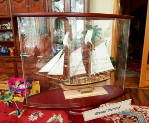 Finished oval showcase with the model schooner Polotsk